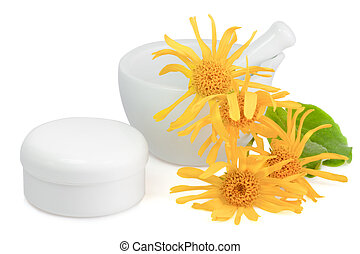 Arnica hand cream - Arnica blossoms with mortar and cream...