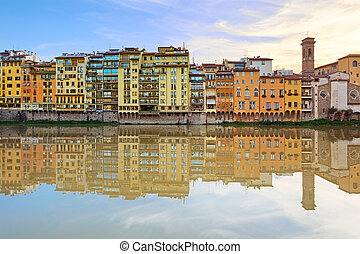 Arno river and historical buildings architecture landmark in Florence on sunset. Tuscany, Italy, Europe.