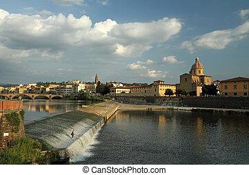 Arno river with the Pescaia di Santa Rosa and church San...