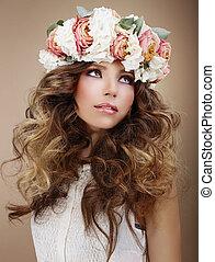 Aroma. Genuine Brunette in Wreath of Flowers Looking Up