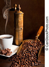 Aroma of coffee - Antique coffee grinder with steaming...