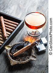 Aroma of cognac and burnig cigar