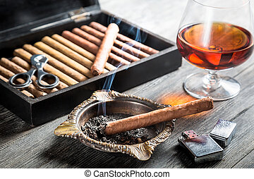 Aroma of cognac and cigar fuming