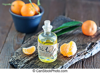 aroma oil and tangerines on the wooden board