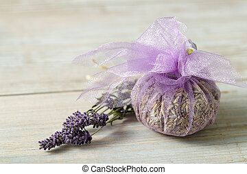 Aroma sachet of dried lavender flowers on wooden background...