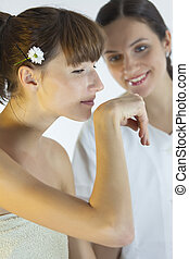 aroma therapy - young woman smells on her hand in a wellness...