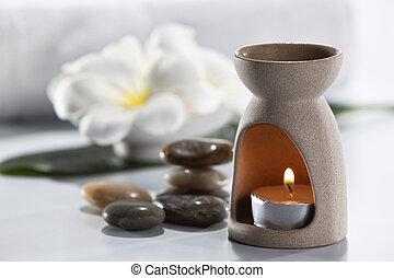 aromatherapy - Aromatherapy candle and frangipani flower