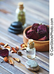 Aromatherapy - Beauty care objects on wooden surface