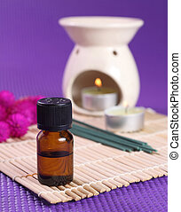 Aromatherapy - Bottle of essential oil, aromatherapy burner ...