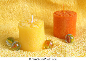 Aromatherapy candles on a towel