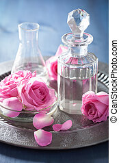 aromatherapy set with rose flowers and flasks