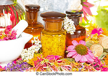Aromatherapy still life with fresh flowers, a ceramic pestle...