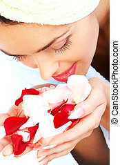 aromatherapy - Young pretty woman holding and smelling pink...