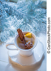 Aromatic and sweet tea with orange and cinnamon for Christmas
