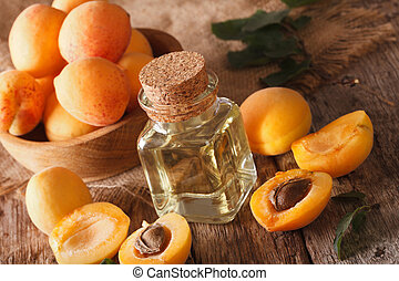 Aromatic apricot oil in a glass bottle close-up. Horizontal