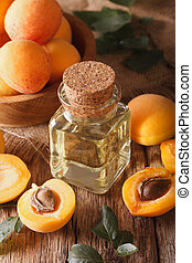 Aromatic apricot oil in a glass bottle close-up. vertical
