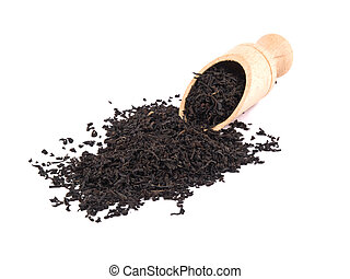 Picture of dry aromatic black tea leafs and wooden shovel on white background