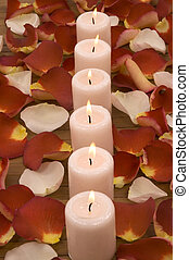 Aromatic Candles - Aromatic candles and colorful rose petals