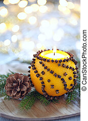 Aromatic Christmas orange with candle