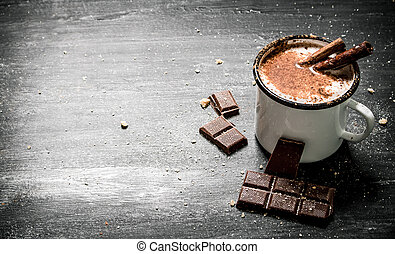 Aromatic cocoa drink with cinnamon and chocolate.