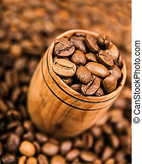 aromatic coffee beans in a wooden cup