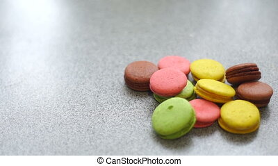 aromatic cup of coffee and color biscuits on the table close...