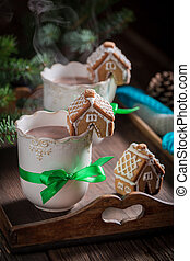 Aromatic gingerbread cottages with tasty cocoa for Christmas