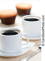 Aromatic hot coffee with muffins