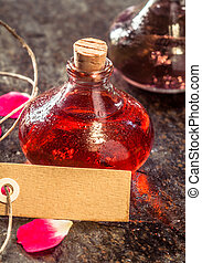 Aromatic Oils and Blank Tag on Rustic Table