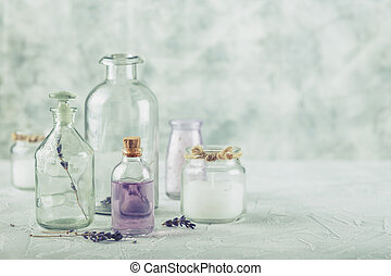 Aromatic oils and salt - Glass bottles and jars with...