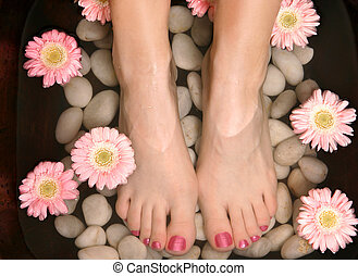 Aromatic relaxing foot bath pedispa - Female feet in a ...