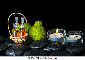 Aromatic spa concept of bergamot fruits, candles and bottles ess