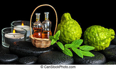 Aromatic spa concept of bergamot fruits, fresh  mint, candles an