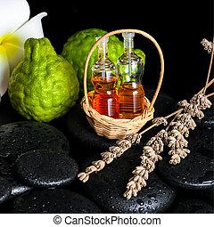 Aromatic spa concept of bottles essential oil, bergamot fruits,