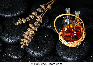 Aromatic spa concept of bottles essential oil in basket and drie