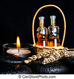 Aromatic spa concept of bottles essential oil in basket, dried l