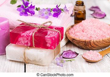 Handmade soap, salt shower and flower.