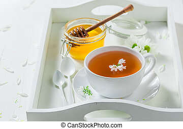 Aromatic tea with honey with spring flowers