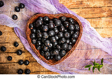Aronia berries in a wooden box top view