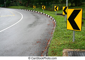 Around the bend - Left arrow Street signs around the bend of...