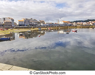 Arousa island seafront reflected on the sea