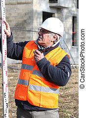 arpenteur, site construction, expérimenté