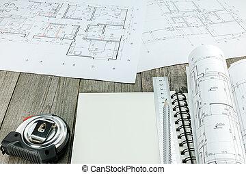 arquitectónico, proyecto, con, bloc, y, herramientas, en, gris, escritorio de madera
