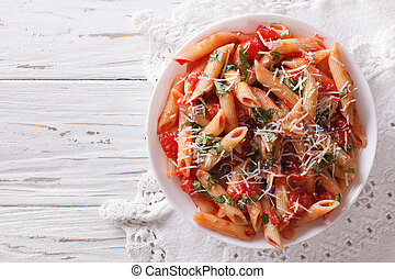 Arrabiata pasta penne with Parmesan cheese. Horizontal top ...
