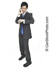 Arrange - An asian businessman arranges a meeting by phone