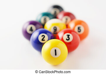 Arrange billiard balls - Close-up photography. on white...