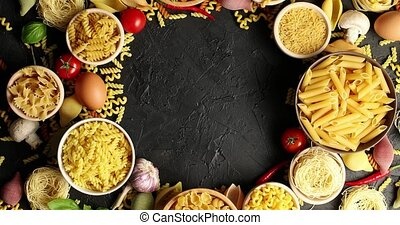 Arranged bowls with pasta assortment - From above shot of...