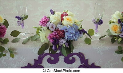 arrangement of different flowers is on the table