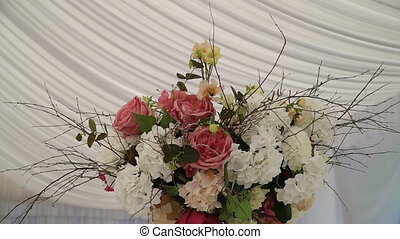 Arrangement of flowers in a place of wedding.