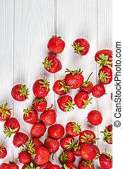 Arrangement of fresh strawberries on white background.